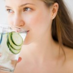 SkinnyTimes.WomanDrinkingCucumber Water 150x150 Benefits of Drinking Water